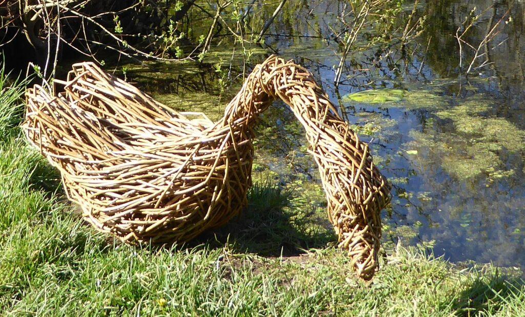willow swan sculpture sitting down