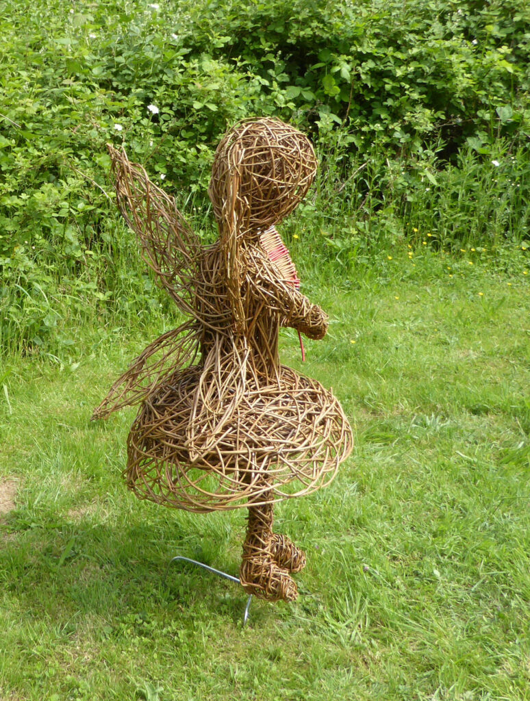 fairy child willow sculpture viewed from behind