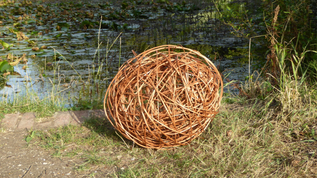 willow oval sculpture by lakeside