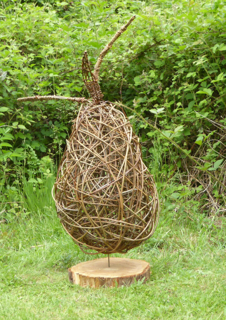 Large pear willow sculpture on wooden slice