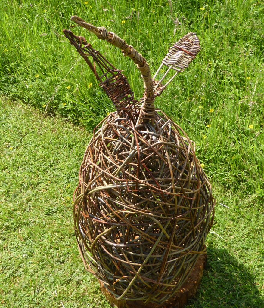 large willow pear sculpture on grass