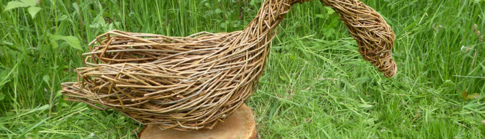 swan willow sculpture on base